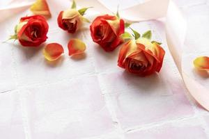Frame made of red  roses and petals photo