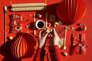 Fortune cookie and Chinese decorative objects, red background photo