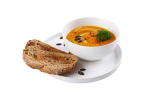 Plate of pumpkin soup with bread toast photo