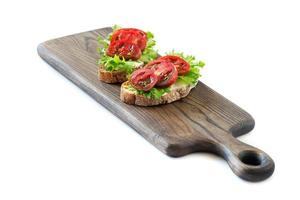 Two sandwiches with tomatoes photo