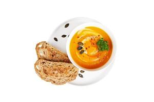 Bowl of pumpkin soup - mashed with toasted bread photo