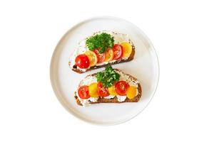 Two sandwiches with cheese and tomatoes photo