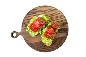 Two sandwiches with soft cottage cheese, tomatoes and salad photo