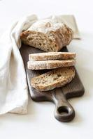 Sliced loaf of bread on a board photo