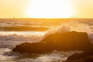 Natural scene of big waves hit rocky coast at Baker beach. photo
