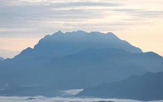Big mountain range Doi Luang Chiangdao in tropical rainforest. photo