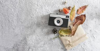 Autumn flat lay layout with vintage camera, word autumn photo