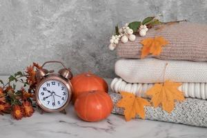 Autumn still life with knitted sweaters photo
