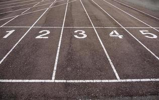 Numbers on a running track photo