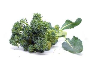 Broccoli with leaves isolated on white background photo