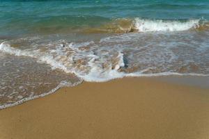 Foamy Wave On The Sandy Beach. Beautiful wave on the beach. photo