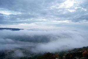 Valley covered with mountain morning fog. Mist in the valley. photo