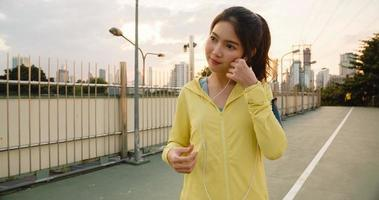 Asia athlete lady exercises using smartphone for listen to music. photo