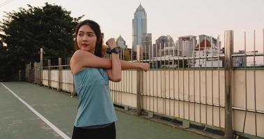Asia athlete lady exercises doing stretch work out in urban. photo