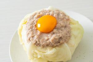 Steamed cabbage stuffed minced pork and egg yolk photo