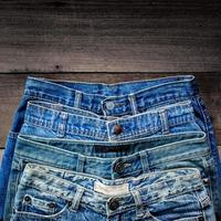 Blue jean and jean lack texture on table, Jeans are overlapping. photo