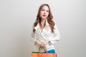 Portrait beautiful Asian woman holding shopping bag photo