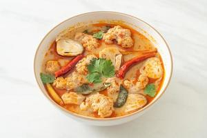 Spicy boiled pork soup with mushroom - Tom Yum photo