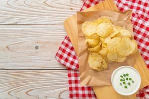 Potato chips with sour cream photo