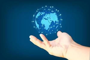 Business hand holding earth globe on blue  background photo