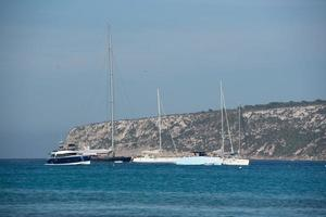 Yachts on Es Calo beach in Formentera in summer 2021. photo