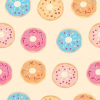 Seamless pattern with testy colorful donuts on beige vector