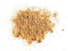 Ginger Zingiber officinale powder over white photo