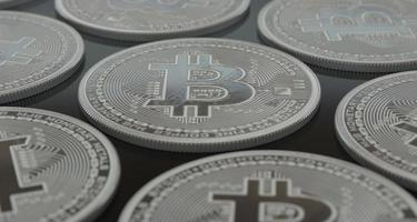 Bitcoins cryptocurrencies laid on a floor photo
