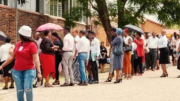 Limpopo, South Africa, Feb 08, 2019 - Crowd of people near a building photo