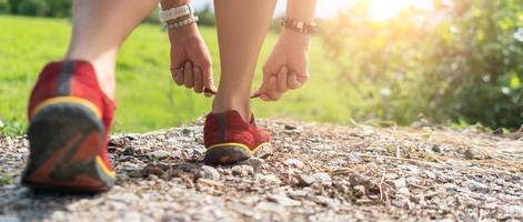 Woman wear running shoe on to walking. photo