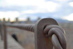 Piece of handrail of a staircase with direction to infinity photo