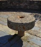 Round stone antique table adorning a courtyard of an ancient building photo