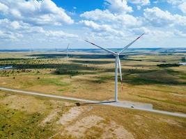 Wind turbines at the countryside in summer day, aerial view photo