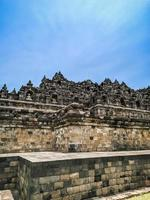 Borobudur temple from the side with a clear sky photo