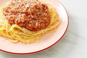 Pork bolognese spaghetti with parmesan cheese photo