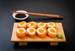 Fresh salmon sushi roll with mayonnaise and shrimp egg photo