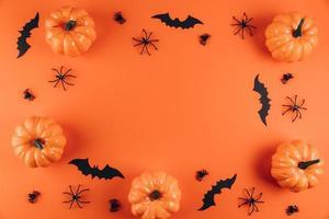 Halloween decorations on the orange background. photo