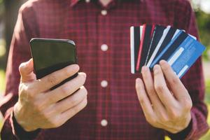 Businessman holding smartphone and credit card. photo