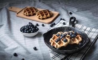 Belgium waffle with blueberry on pan photo