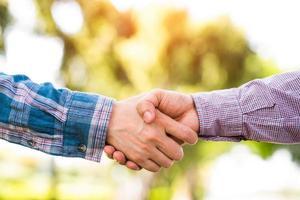 Business team greeting handshake. photo