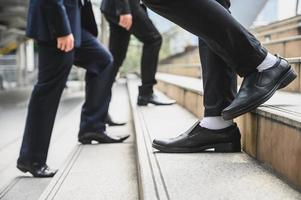Business people walking on the stairs photo