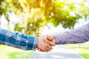 Business team greeting handshake photo
