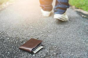 Wallet on the floor.Man lost his wallet photo