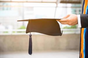 Close up Graduation holding graduation cap education concept photo