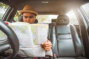 Man look at the map inside car photo
