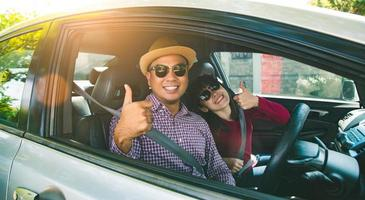 Happy moment couple asian man and woman sitting in car. photo
