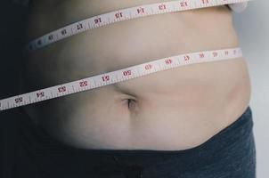 Human body and fat body, Paunch or belly and overweight of people. photo