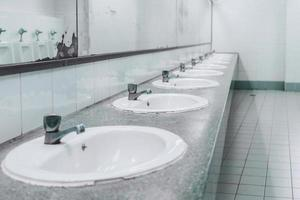 Public toilet and Bathroom interior with wash basin and toilet room. photo