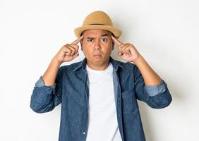 Confused man on a white background photo