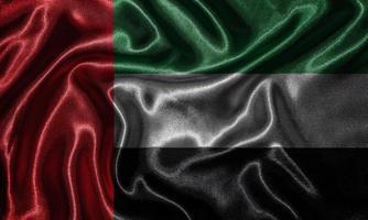 papel tapiz de la bandera de los Emiratos Árabes Unidos y bandera ondeando por la tela. foto